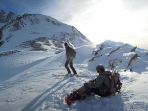 Ski touring with snowboarder